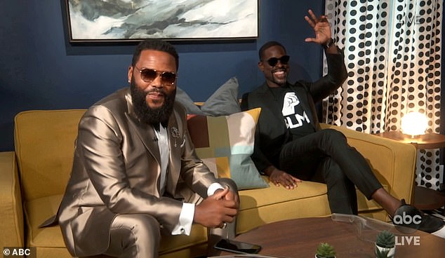 Looking sharp: Anthony Anderson donned a metallic suit and hung out with Sterling K. Brown